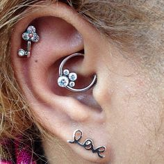 Daith piercing by lovely guest piercer @Ashley Misako with Anatometal cz gem cluster in a captive bead ring (at NoKaOi Tiki Tattoo and Piercing)