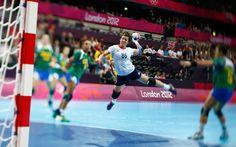 Britain's Marie Gerbron takes a shot against Brazil in their women's handball Preliminaries Group A match at the Copper Box venue