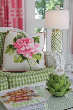 Porch, white wicker, pink and green. Kimberly McCluskey Design Services.