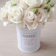 Roses in a coffee jar . . so pretty . .