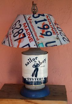 Old license plates and other cast-off items can make really neat-looking lamps. #repurposed #lighting