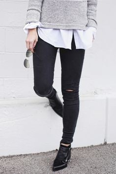 So cute! Get the look with an oxford shirt layered underneath a cropped sweater with black jeans and boots.