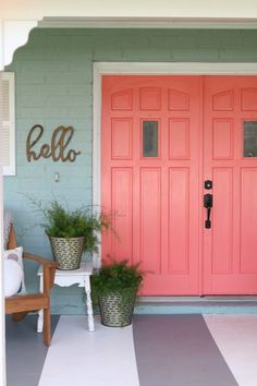 Coral door for the girls' room :) Loving these bright front doors! So easy to make a statement with bold front door paint choices using Curb Appeal paint. Such cheery front doors on a colorful porch. Coral Front Doors, Coral Door, Painted Front Doors, Front Door Colors, Front Door Decor, Front Porch, Door Paint Colors, Exterior Paint Colors For House, Paint Colors For Home
