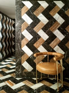 wall-to-wall marble in the most gorgeous pattern, plus the perfect accent camel colored accent chair