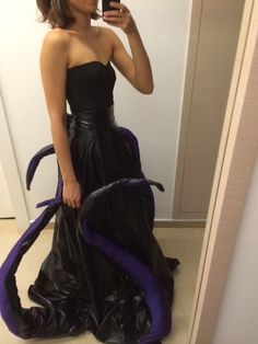 Ursula. I can make a faux leather skirt and pin the tentacles up to it so they don't drag