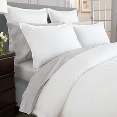 Bring hotel comfort to your bedroom with the Wamsutta Baratta Stitch MicroCotton Pillow Sham. Adorned with white double baratta stitch embroidery on a pristine white background, the plush pillow sham is the epitome of supreme luxury.
