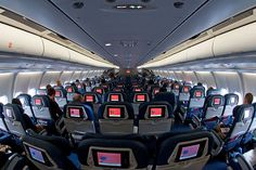 The cabin of  Delta Air lines  Airbus A330-300 N813NW flight 251 Frankfurt-Detroit. Every seat has a POV, meaning everyone has their own video screen in the back of the seat in front. Averi took this to Paris from Detroit.