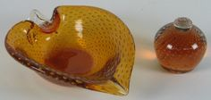 """Erikson amber air trapped bubble paperweight vase base. No mark. Size: 3 """"H x 3 1/4 Diam. widest part. Leaf form amber glass dish with air trapped bubbles, polished bottom."""