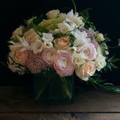 Flower delivery arrangement - white, pink, light orange roses, and ranunculus