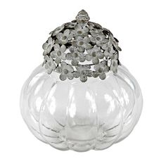 Large Kirsten Jar with a ribbed silhouette and openwork lid.Product: Jar and lidConstruction Material: Metal and glass...