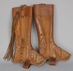 TWO PAIR LEATHER GAITERS with APPLIQUE and EMBROIDERY, LATE 19th - EARLY 20th C. Both brown, one Mexican with fringe and button closures, one continental with self laces (stains).
