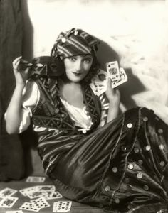 Actress Carmel Myers plays a Gypsy fortuneteller