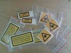 Laser aperture warning labels