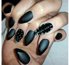 Stiletto Nails.. kinda wanna try this style but I'm afraid I'll poke an eye out.