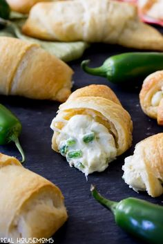 Jalapeno Popper Crescent Roll split in half to show the creamy, cheesy filling with diced jalapenos