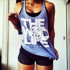 The WOD Life lavender graphic tank black sports bra shorts
