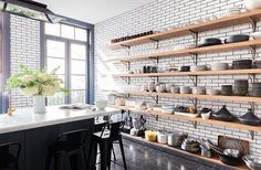 This five-stories West Village home belongs to New York cooking school, Haven's Kitchen founder, Alison Cayne. West Village, Shelving Design, Open Shelving, Custom Shelving, Shelving Ideas, Shelving Decor, Havens Kitchen, New York Townhouse, Townhouse Interior