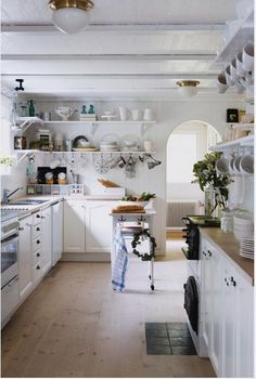 white cabinets, wood floor, wood ceiling...