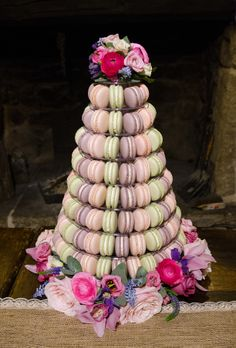 The Cruck Barn Photo Shoot with Bolton Abbey Weddings. Macaron wedding tower with flowers. Venue: http://www.craven-cruckbarn.co.uk/weddings.htm  Photos: http://www.colinmurdochstudio.com Flowers http://leafycouture.co.uk/ and vintage styling by www.rosepinkvintage.co.uk