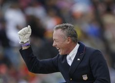 Jan Ebeling of the United States celebrates after he competes with his horse Rafalca in the equestrian dressage team competition at the 2012 Summer Olympics, Aug. 7th