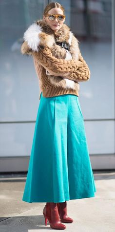 Olivia Palermo proved that cold-weather fashion can still be chic, hitting the New York Fashion Week circuit in a chunky camel cable knit and a bright turquoise midi skirt, with a fur stole, Westward Leaning shades, and burgundy Louboutin boots.