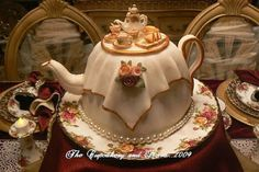 teapot cake | very pretty teapot-shaped cake complete with tea-sets spread on top ...