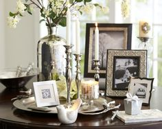 Silver accents, from picture frames to chargers, candlestick and vase, give a room subtle sparkle