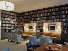 Traditional Library with Pendant Light, Crown molding, Built-in bookshelf, Carpet