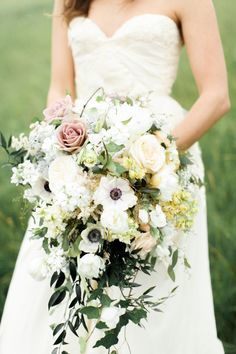 romantic cascading bouquet of roses and anemones by  Allen's Flowers