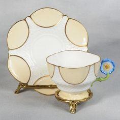 AYNSLEY TEACUP & SAUCER - WHITE/BEIGE/GOLD TRIM  & BLUE FLOWERED HANDLE