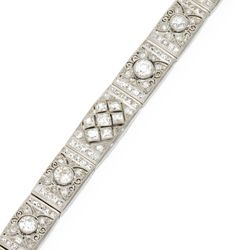 Platinum and diamond, circa 1925. Set with 4 larger old European-cut diamonds weighing approximately 1.80 carats, further set with French-cut, old European-cut, single-cut and rose-cut diamonds weighing approximately 7.70 carats, length 7 inches, two diamonds missing.