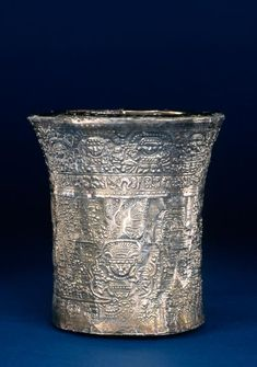 Large cup, AD 800-1450, hammered silver - formed of sheet silver, and has repousse decoration created by pushing out from the inside surface of the metal, Peru, North coast, Chimu or Sican