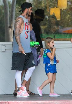 Fine dining: David Beckham was spotted going out for breakfast with his daughter Harper in Los Angeles' ritzy Bel-Air neighbourhood on Thursday