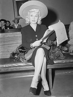 Actress Mae West checks over a few legal details as she appears in Los Angeles court to fight separate maintenance plea of her husband, Frank Wallace, which she is contesting with a suit for divorce. Old Hollywood Glamour, Hollywood Stars, Classic Hollywood, Hollywood Celebrities, Hollywood Actresses, Mae West Movies, Dick Haymes, Eddie Fisher, Actor John