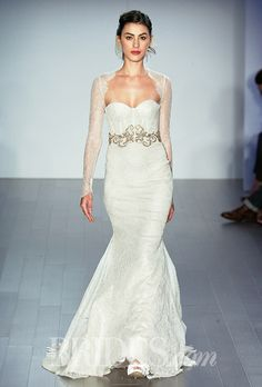 Brides.com: . Trend: Corset Bodices. Strapless lace mermaid wedding dress with a sweetheart neckline, beaded belt, and sheer lace jacket, Lazaro