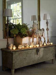 This display would be even better/safer with flameless/rechargeable votives and pillars. Check out Luminara on qvc.com.