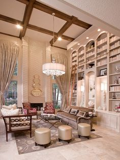 This grand living room was once full of dark, heavy woodwork that made its large scale even more uninviting. Designer Cindy Aplanalp was challenged with a room that needed to be a comfortable family space and a chic spot for entertaining. The plush furnishings and silk window coverings… More