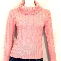 """Sele Pink Long Sleeves Turtleneck Sweater. This turtleneck sweater by Sele is absolutely stunning. It has a little sparkle to it and never been worn. 78% Acrylic, 14% Nylon, 5% Lurex and 3% Spandex. Armpit to armpit 15"""", Sweater Length 21"""", Sleeve Length 25"""". Sele Sweaters Cowl & Turtlenecks"""