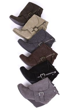 Add a dash of style to your look with this stylish Bilocate bootie, featuring soft faux suede, and a unique fold over cuff with an outside zipper and buckle detail. Finished with a side zip entry and stacked wedge heel. This bootie has a heel height of 2.5 inches. Blowfish Shoes has got your fall fashion covered this season!
