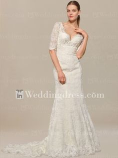Vintage wedding dress features scalloped Lace V-neckline.