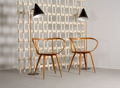 Paavo Tynell Cone Lamps, Early George Nelson Pretzel chairs with a Richard Harvey Bone Screen. Offered by theexchangeint.com