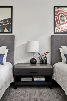 A guest bedroom blends classic pieces with a personalized feel, from the photographs to the flowers, and simple nightstand styling. #modernbedroom #modernguestbedroom #guestbedroom
