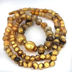 Rare collection of gold in glass beads, collected from Balochistan Pakistan, age est. 700 - 1500 years old.