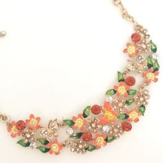 """NEW Orange Floral Statement Necklace New orange floral necklace. Orange hues enamel, lots of rhinestones on gold tone metal for lots of sparkle. 19.25"""" long with lobster closure and 3"""" extender. Absolutely beautiful and great quality heavier piece. Jewelry Necklaces"""