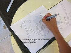 Transfer lettering with carbon paper. This webpage has a whole tutorial for wooden signs.