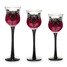 SIMPLY GORGEOUS! A romantic damask motif and midnight black stems add drama to our curvy glass candle holders. My favorite way to use these is with our exclusive PartyLite votives. www.PartyLite.biz/loubelieves