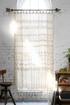 Look at that arrow curtain rod! Have to have it! Magical Thinking Macrame Wall Hanging