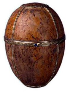 The 'Birch' Faberge Egg ~ made in 1917 ~ as a gift from Czar Nicholas to his Mother but was never presented to her. It was made of Karelian Birch (a birch that grows only in Russia) rather than the usual gold & precious gems. However it contained an expensive surprise ~ a miniature elephant made of gold, silver, rose-cut diamonds & enamel. The elephant surprise has disappeared ~ thought to have been stolen by soldiers ~ though the key to wind it exists. The whereabouts of this egg were no...