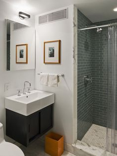 floating vanities in a small bath provide storage while visually keeping the space open