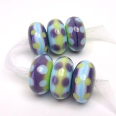 The cool soft, almost smudged, colors on these beads are delightful!